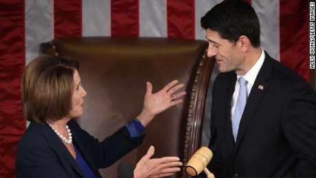 WASHINGTON, DC - OCTOBER 29:  U.S. House Minority Leader Rep. Nancy Pelosi (D-CA) (L) hands a gavel to incoming Speaker of the House Rep. Paul Ryan (R-WI) (R) in the House Chamber of the Capitol October 29, 2015 on Capitol Hill in Washington, DC. Rep. Ryan has been elected to succeed Rep. John Boehner (R-OH) to be the new Speaker of the House.  (Photo by Alex Wong/Getty Images)