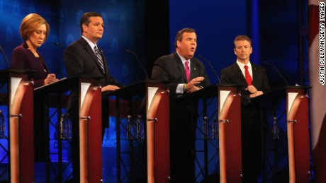 Presidential candidate New Jersey Gov. Chris Christie (2nd R) speaks  while Sen. Rand Paul (R) (R-KY), Carly Fiorina (L), and Sen. Ted Cruz (R-TX) look on during  the CNBC Republican Presidential Debate at University of Colorados Coors Events Center October 28, 2015 in Boulder, Colorado.