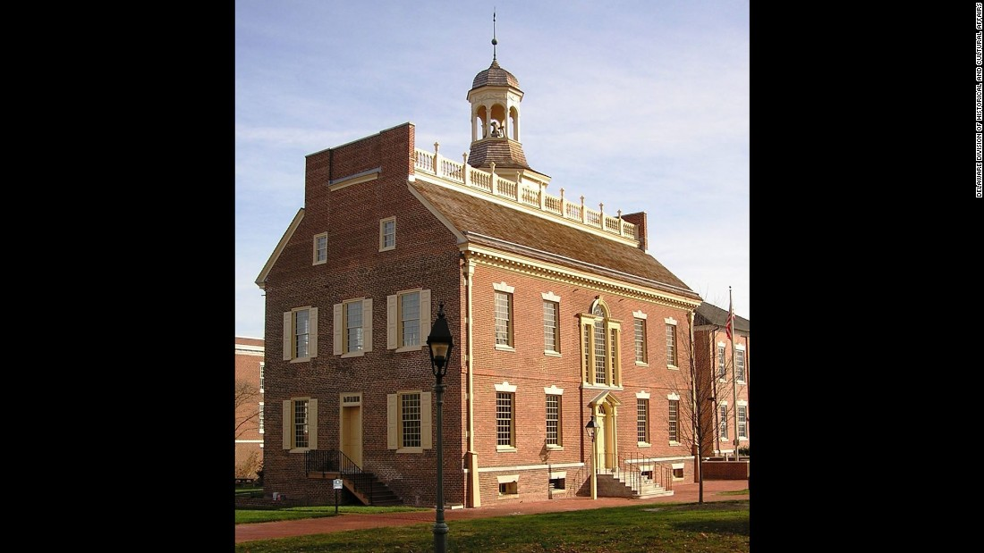 The pardon was issued at the Old State House in Dover, which served many purposes. This is where Samuel D. Burris was tried and convicted. He was auctioned on the building's marble steps (which have been replaced).