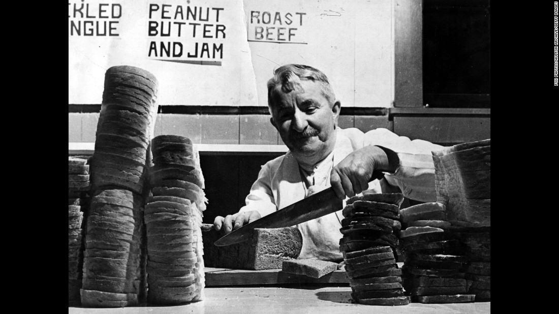 Englishman Harry Hawkins prepares peanut butter and jam sandwiches for lumberjacks in the Canadian Rockies in 1941.