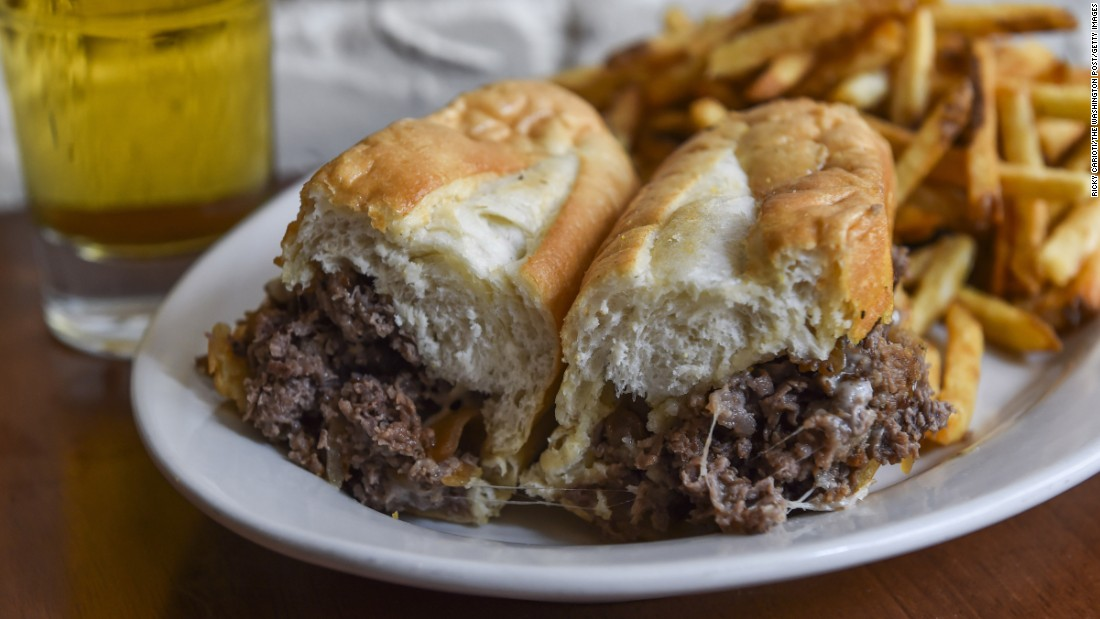 The classic Philly cheesesteak contains melted Provolone over thinly sliced grilled steak on a long hoagie roll. When in Philadelphia visit Pat's or Geno's for an authentic, and greasy, taste of history.