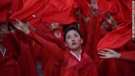 Dancers perform during a mass military parade at Kim Il-Sung square in Pyongyang on October 10, 2015. North Korea was marking the 70th anniversary of its ruling Workers' Party. AFP PHOTO / Ed Jones        (Photo credit should read ED JONES/AFP/Getty Images)