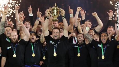 Richie McCaw lifts the Webb Ellis Cup as New Zealand retains the Rugby World Cup following a 34-17 victory over Australia at Twickenham.