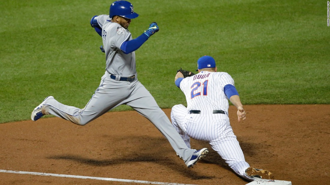 The Royals' Alcides Escobar is out at first as the Mets' Lucas Duda takes the throw during the third inning.