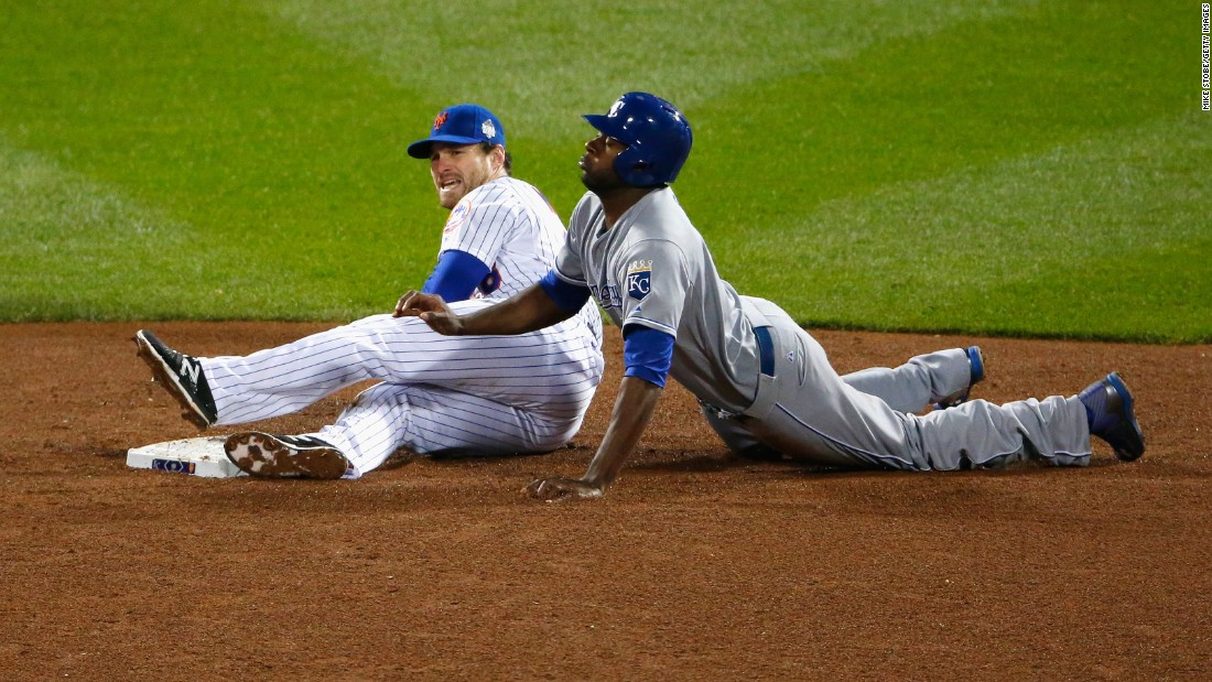 Lorenzo Cain of the Royals slides safely into second base in front of Daniel Murphy of the Mets in the sixth inning.