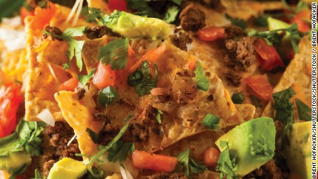Loaded Beef and Cheese Nachos with Cilantro and Lime; Shutterstock ID 308132735
