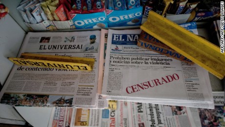 "Today's issue of Venezuelan daily ""El Nacional"" showing an empty space with the word ""Censured"" in red on its frontpage, at a newspapers stall in Caracas, August 18, 2010. Venezuela has forbidden printed news media from publishing violent, bloody or grotesque images"" because of the moral and psycological harm they could inflict upon children.  AFP PHOTO/Juan BARRETO (Photo credit should read JUAN BARRETO/AFP/Getty Images)"