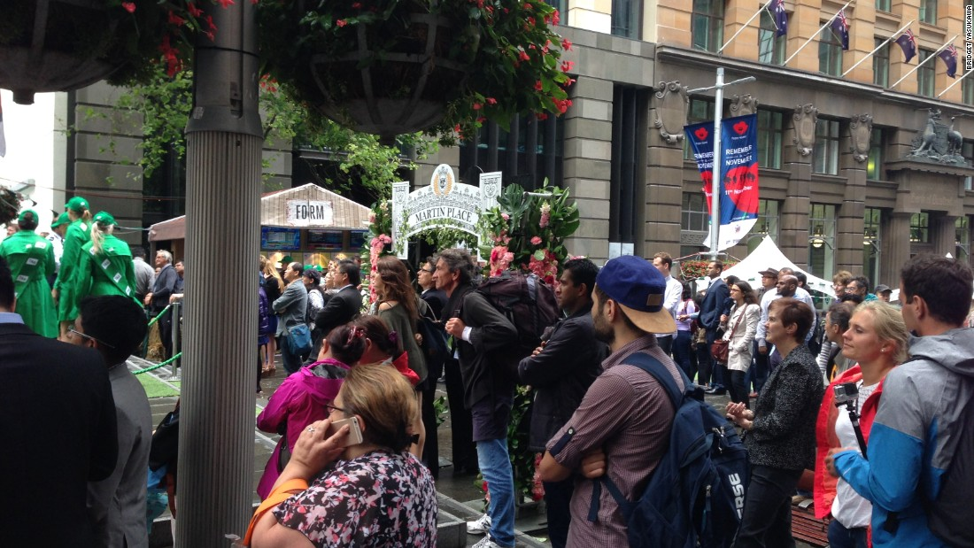 "Crowds gather in Sydney's Martin Place -- <a href=""http://edition.cnn.com/2014/12/15/world/asia/australia-sydney-hostage-situation/"">where the Lindt  Chocolate Cafe shooting took place in December 2014</a> -- to watch the race."
