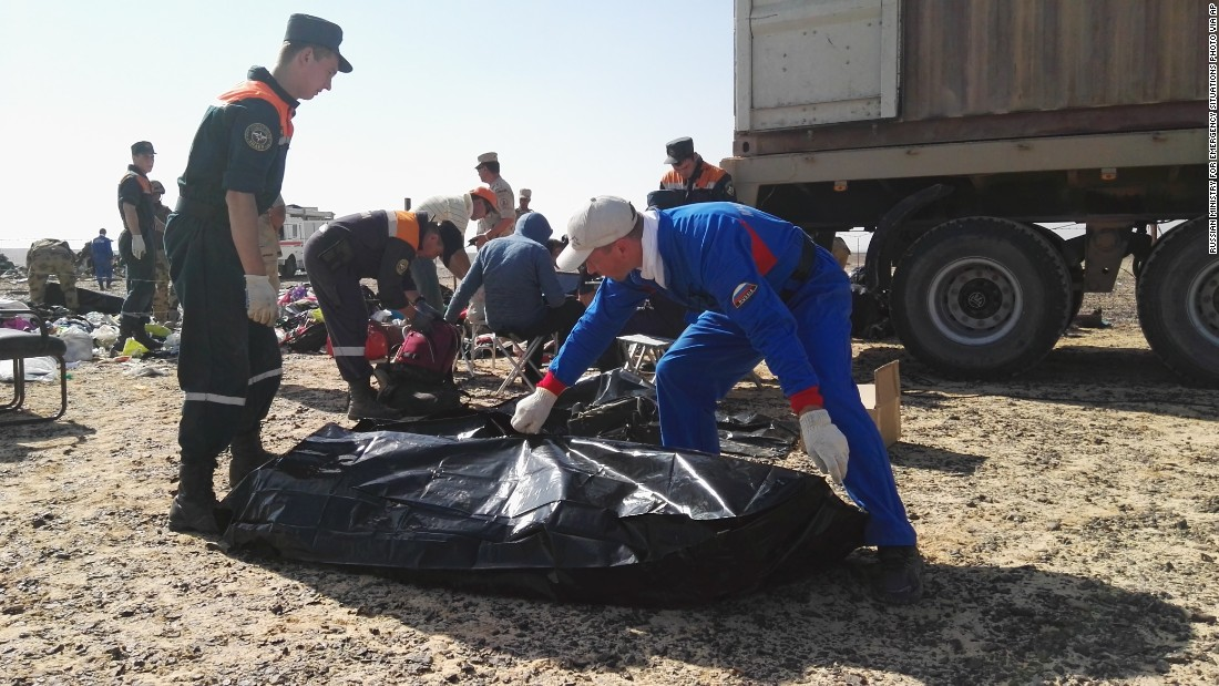 Russian emergency personnel collect personal belongings of victims at the crash site in Hassana, Egypt, on November 2.