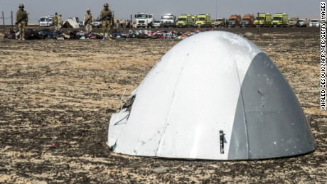 Egyptian army soldiers stand guard next to the plane nose of a crashed A321 Russian airliner at the site of the wreckage in Wadi al-Zolomat, a mountainous area in Egypt's Sinai Peninsula on November 1, 2015. International investigators began probing why a Russian airliner carrying 224 people crashed in Egypt's Sinai Peninsula, killing everyone on board, as rescue workers widened their search for missing victims. AFP PHOTO / KHALED DESOUKI        (Photo credit should read KHALED DESOUKI/AFP/Getty Images)