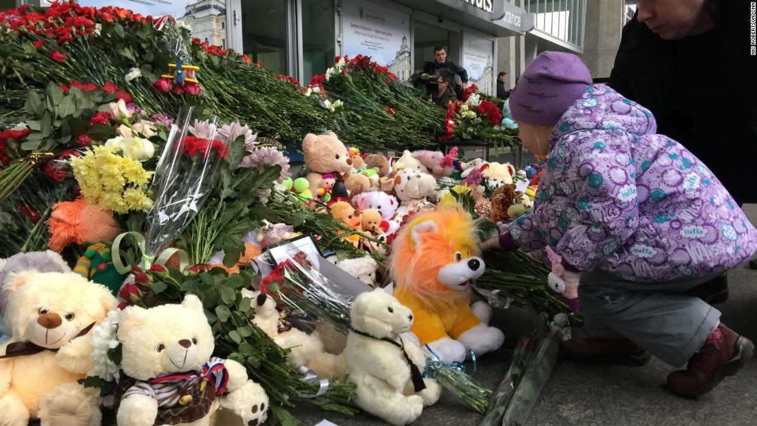 Children came to leave flowers the day after the crash.