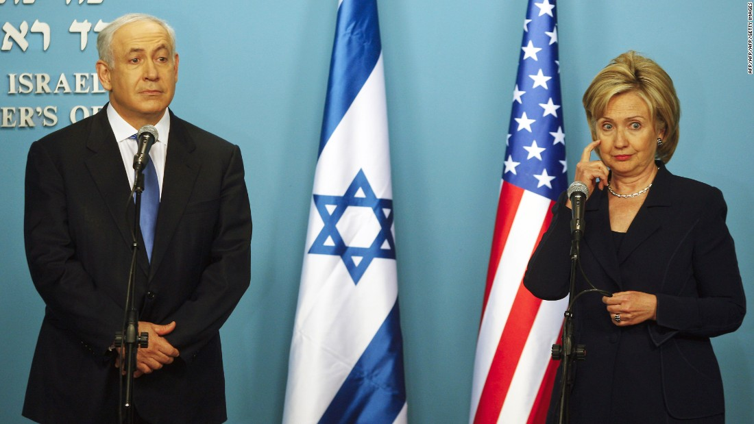 "Clinton gestures during a joint news conference with Netanyahu in Jerusalem on October 31, 2009.<br /><br />Clinton hailed Netanyahu's stance on West Bank settlements as ""unprecedented."""