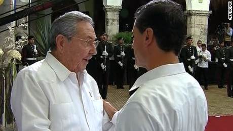 Shows hug between the two presidents    Mexican President Enrique Pena Nieto will meet with his Cuban counterpart, President Raul Castro, who is visiting for the first time in 13 years. The two leaders are expected to discuss regional and bilateral issues, including a recent surge of Cuban migrants entering Mexico in their bid to reach the United States.