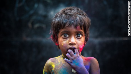 A boy is colored by the marks of the Hindu festival Holi in Chennai, Indian, by iReporter Ashok Saravanan.