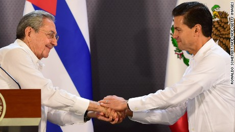 Mexican President Enrique Pena Nieto (R) and Cuban President Raul Castro shake hands during a joint press conference at the government palace in Merida, Yucatan State, Mexico, on November 6, 2015. Castro's first state visit to Mexico since he took office in 2006 takes place in the eastern colonial city of Merida, where the two leaders will discuss a range of issues and sign a series of agreements.   AFP PHOTO / RONALDO SCHEMIDTRONALDO SCHEMIDT/AFP/Getty Images
