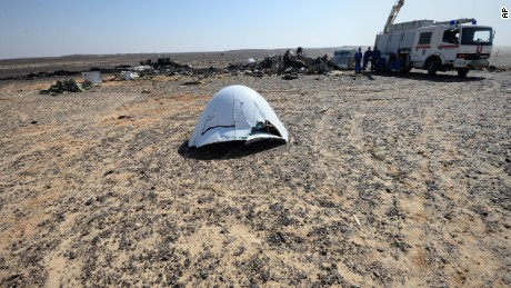 In this Russian Emergency Situations Ministry photo, made available on Monday, Nov. 2, 2015, Russian Emergency Ministry experts work at the crash site of a Russian passenger plane bound for St. Petersburg in Russia that crashed in Hassana, Egypt's Sinai Peninsula, on Monday, Nov. 2, 2015. A Russian cargo plane on Monday brought the first bodies of Russian victims home to St. Petersburg, from Egypt.(Russian Ministry for Emergency Situations photo via AP)