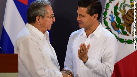 Mexican President Enrique Pena Nieto (R) and Cuban President Raul Castro chat during a joint press conference at the government palace in Merida, Yucatan State, Mexico, on November 6, 2015. Castro's first state visit to Mexico since he took office in 2006 takes place in the eastern colonial city of Merida, where the two leaders will discuss a range of issues and sign a series of agreements.   AFP PHOTO / RONALDO SCHEMIDTRONALDO SCHEMIDT/AFP/Getty Images