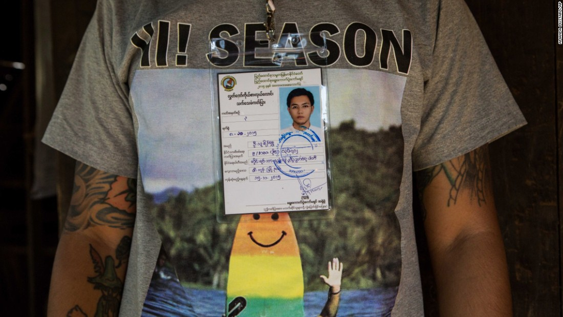 Thu Ryain Shwe, 26, of the National Unity Party, one of the youngest candidates in the parliamentary election, wears his candidate ID in Zigon.