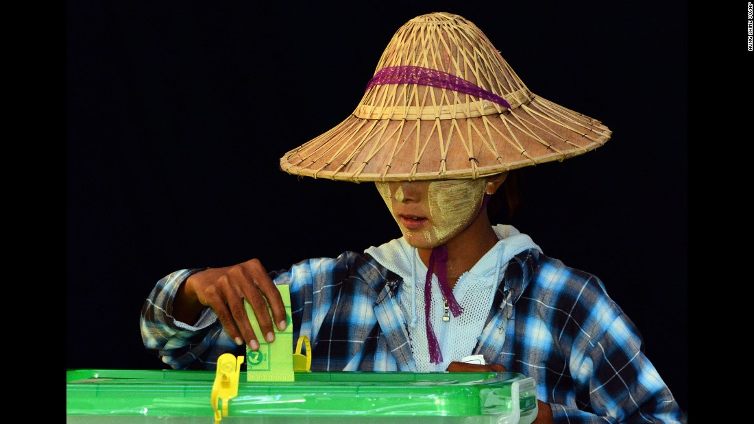A woman casts her vote in a polling station in Naypyidaw, Myanmar, on Sunday, November 8.