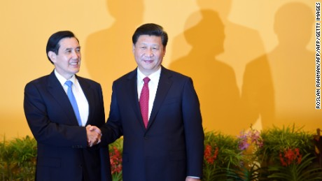 Chinese President Xi Jinping (R) shakes hands with Taiwan President Ma Ying-jeou before their meeting at Shangrila hotel in Singapore on November 7, 2015.  The leaders of China and Taiwan hold a historic summit that will put a once unthinkable presidential seal on warming ties between the former Cold War rivals.    AFP PHOTO / Roslan RAHMAN        (Photo credit should read ROSLAN RAHMAN/AFP/Getty Images)