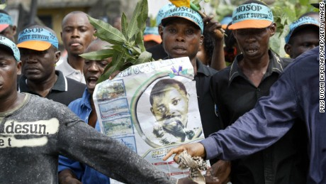 Supporters of executed activist Ken Saro-Wiwa carrying a poster of him during a march in Port Harcourt, Nigeria