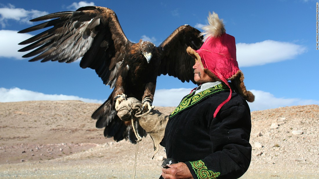 A Kazakh nomad with a Golden Eagle in the Altai Mountains in the western Mongolia. Locals have hunted with eagles for centuries.