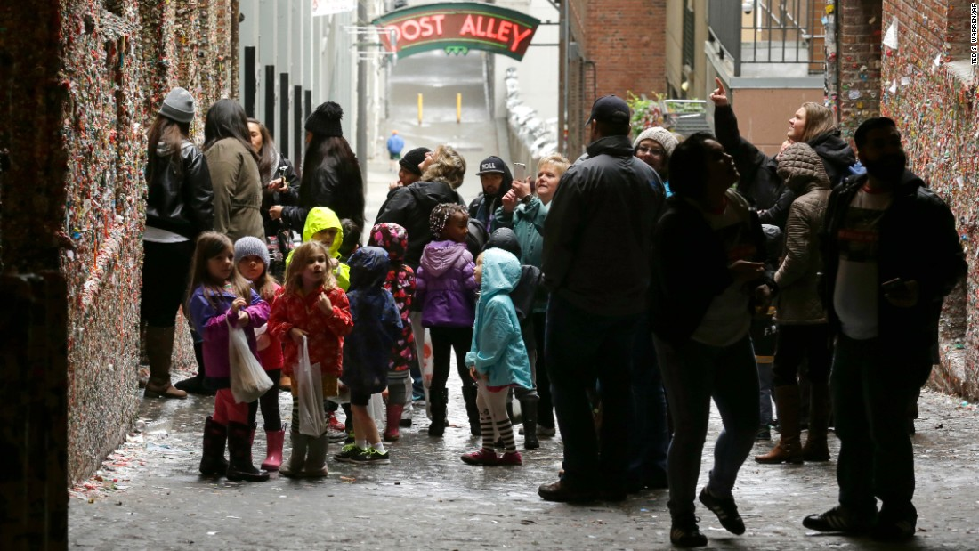 Visitors check out Seattle's gum wall on Monday, November 9, a day before the cleaning started. The cleaning should be complete on Thursday.