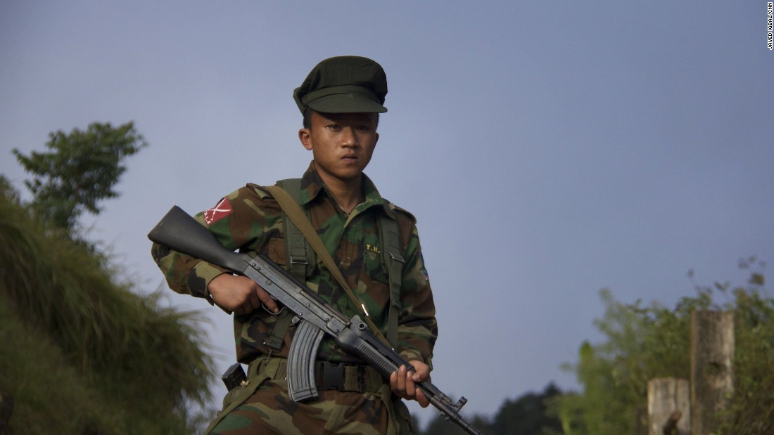 A fighter from the armed rebel movement known as the Ta'ang National Liberation Army, or TNLA, stands in the mountains of north-eastern Myanmar.