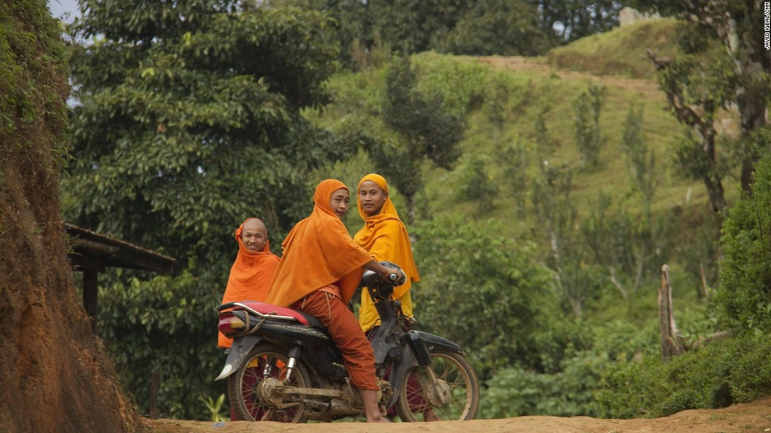 Local men on motorbikes. The TNLA claims to defend the interests of Myanmar's Ta'an ethnic minority, which they say has a population of one million.