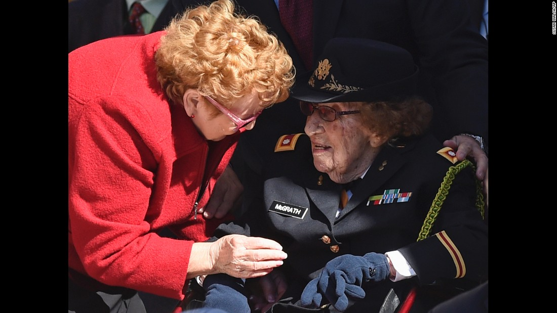 Army Lt. Col. Luta C. McGrath, who at 107 is the oldest known female World War II veteran, is greeted during a Veterans Day ceremony at Arlington National Cemetery in Arlington, Virginia.