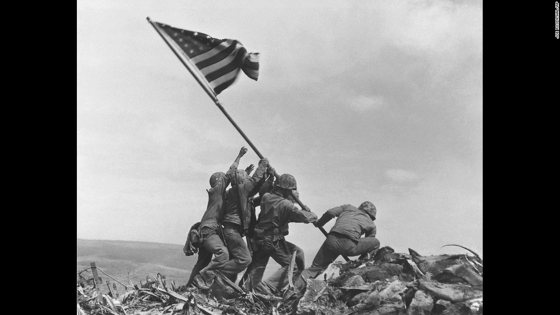 "U.S. Marines of the 28th Regiment, 5th Division, raise the <a href=""http://www.cnn.com/2015/02/22/world/cnnphotos-iwo-jima/"" target=""_blank"">American flag atop Mount Suribachi, Iwo Jima,</a> on February 23, 1945. Only 660 miles from Tokyo, the Pacific island became the site of one of the bloodiest, most infamous battles of World War II. The photo won the Pulitzer Prize in 1945. According to  former executive newsphoto editor at The Associated Press <a href=""http://www.blackdogandleventhal.com/moments/"" target=""_blank"">Hal Buell, author of ""Moments,"" a book on Pulitzer Prize-winning images</a>, photographer Joe Rosenthal used a 4x5 Speed Graphic camera loaded with an Agfa 4x5 film pack (12 shots in a single holder). The lens was 127mm. He exposed f16 at 1/400th. B/W film. ASA is unknown. He made three frames on top of Suribachi: the flag raising, a ""gung ho"" picture and a photo of Marines using a cable or rope to fasten the staff against the wind."