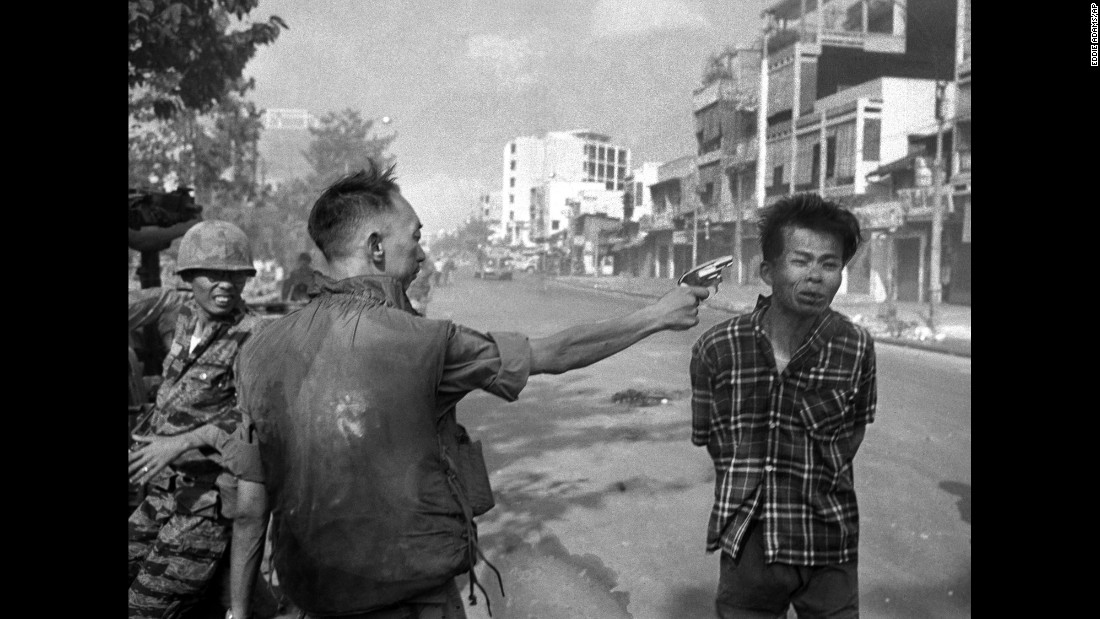 "Gen. Nguyen Ngoc Loan, South Vietnamese chief of the national police, fires his pistol at the head of suspected Viet Cong official Nguyen Van Lem on a Saigon street early in the <a href=""http://www.cnn.com/2014/06/19/world/gallery/iconic-vietnam-war-photos/index.html"">Tet Offensive on February 1, 1968</a>. Buell said photographer Eddie Adams reported long after the shooting that Loan approached him and said, ""They killed many of my people, and yours, too,"" then walked away. Adams made this photo with a Nikon rangefinder camera, loaded with Kodak 35mm, Tri-X film, and using a 35mm lens. He exposed at 1/500th of a second at f11. He was 5 feet away from the scene. The phot won the Pulitzer Prize in 1969."