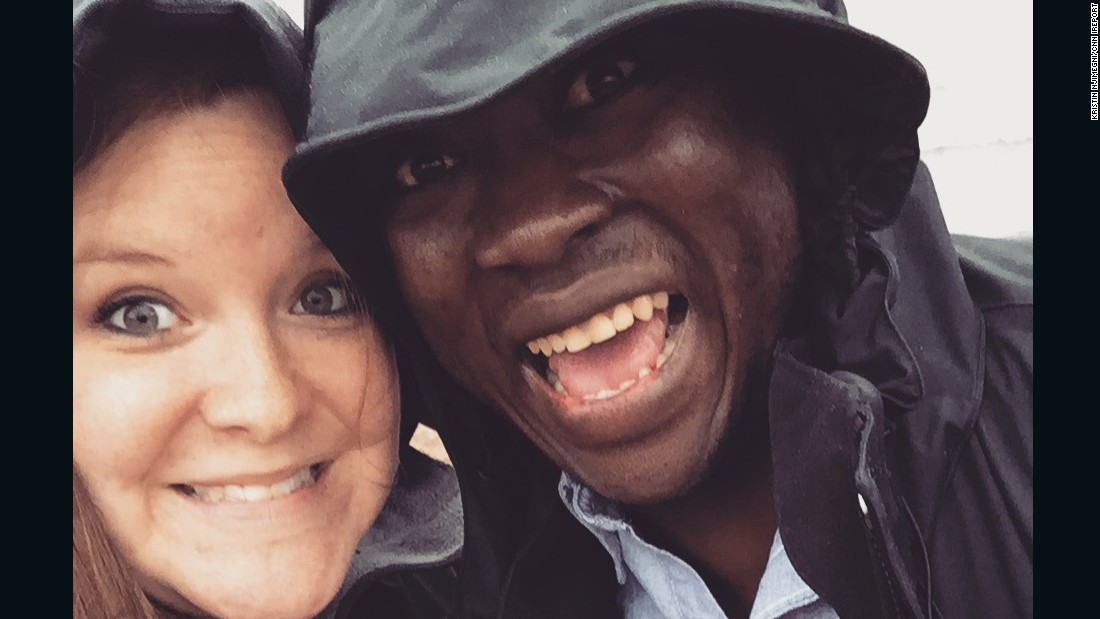 Kristin and Eric Njimegni take a selfie in the rain. The couple met in Moscow while studying and working abroad.