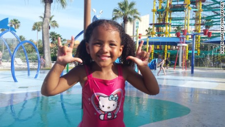 Kaylee poses for the camera at Moody Gardens in Galveston, Texas.