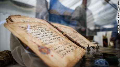 A 750 year old Koran is on show at an annual three-day event for members of the Ahmadiyya Muslim community known as the Jalsa Salana, in Hampshire on August 21, 2015. Over thirty thousand people are expected to attend, culminating in a pledge of allegiance to the Caliph on Sunday. Now in it's 49th year, Muslims from around 100 countries will attend the Jalsa Salana to listen to speeches by the Caliph.  AFP PHOTO/Leon Neal        (Photo credit should read LEON NEAL/AFP/Getty Images)