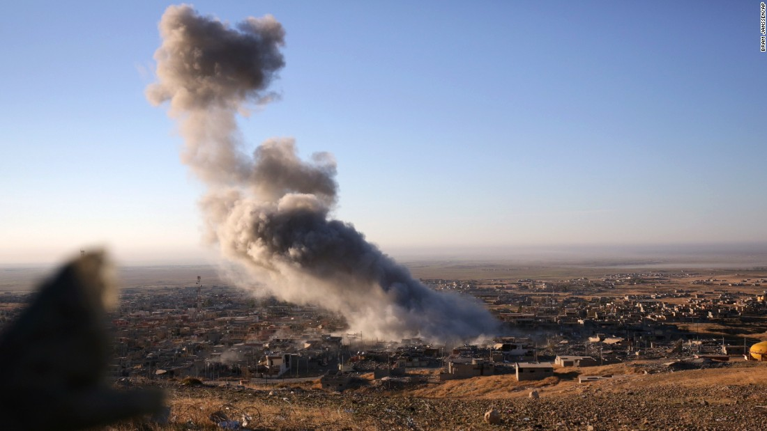 "Smoke rises over the northern Iraqi town of Sinjar on November 12. Kurdish Iraqi fighters, backed by a U.S.-led air campaign, <a href=""http://www.cnn.com/2015/11/13/middleeast/iraq-free-sinjar-isis/"" target=""_blank"">retook the strategic town, </a>which ISIS militants overran last year. ISIS wants to create an Islamic state across Sunni areas of Iraq and Syria."
