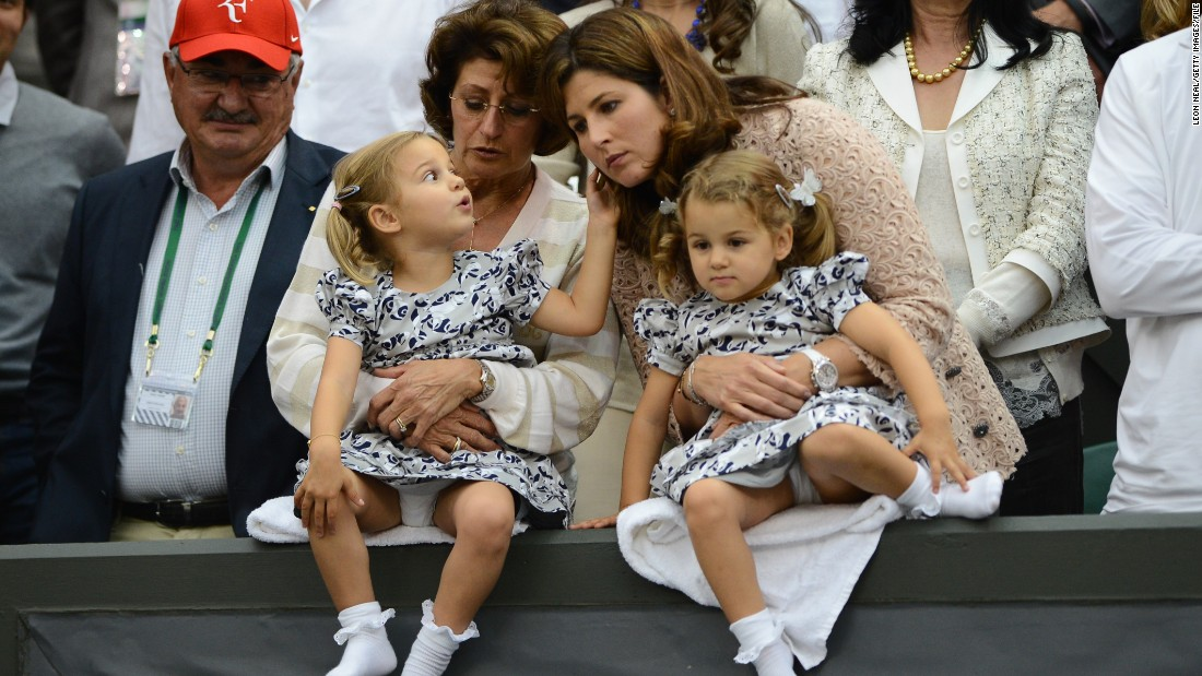 Roger Federer's wife Mirka is among the high-profile WAGs (Wives and Girlfriends of players) seen in the stands. She is pictured here with their twin daughters in 2012.