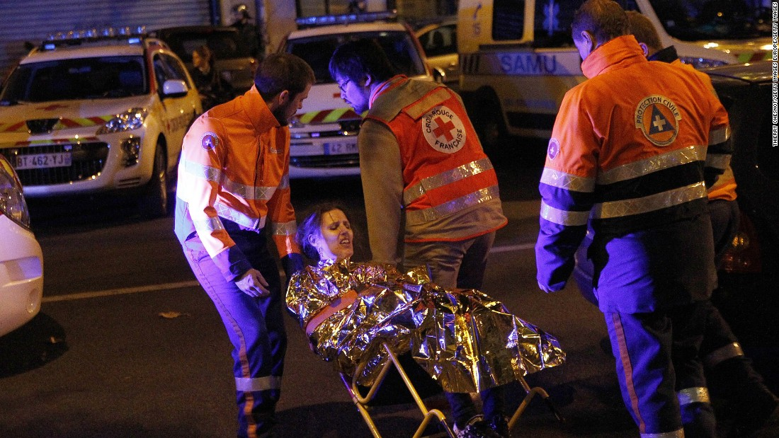 Medics evacuate an injured woman on Boulevard des Filles du Calvaire near the Bataclan early on November 14.