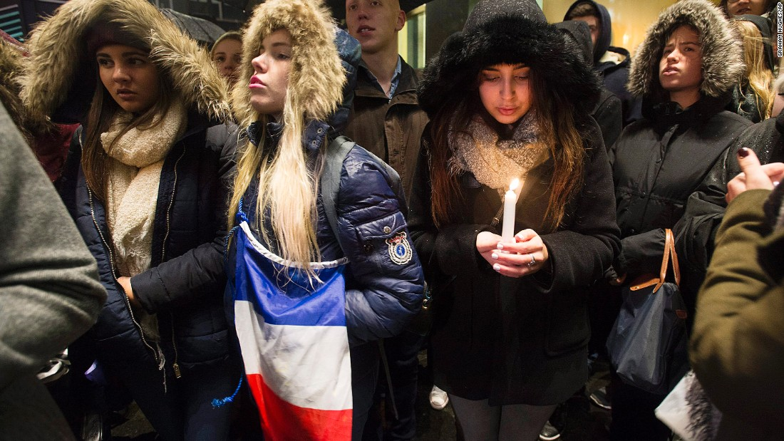 "People attend a vigil outside the French Consulate in Montreal. Prime Minister Justin Trudeau offered ""all of Canada's support"" to France on Friday, November 13, in the wake of the attacks."