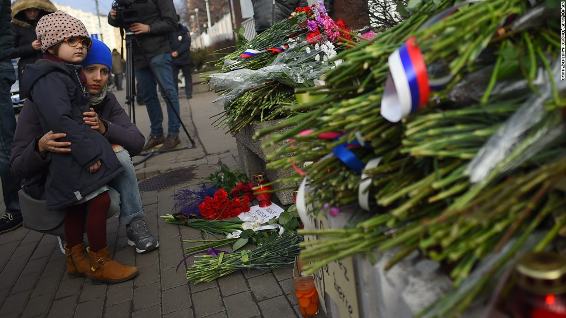People lay flowers outside the French Embassy in Moscow on November 14.