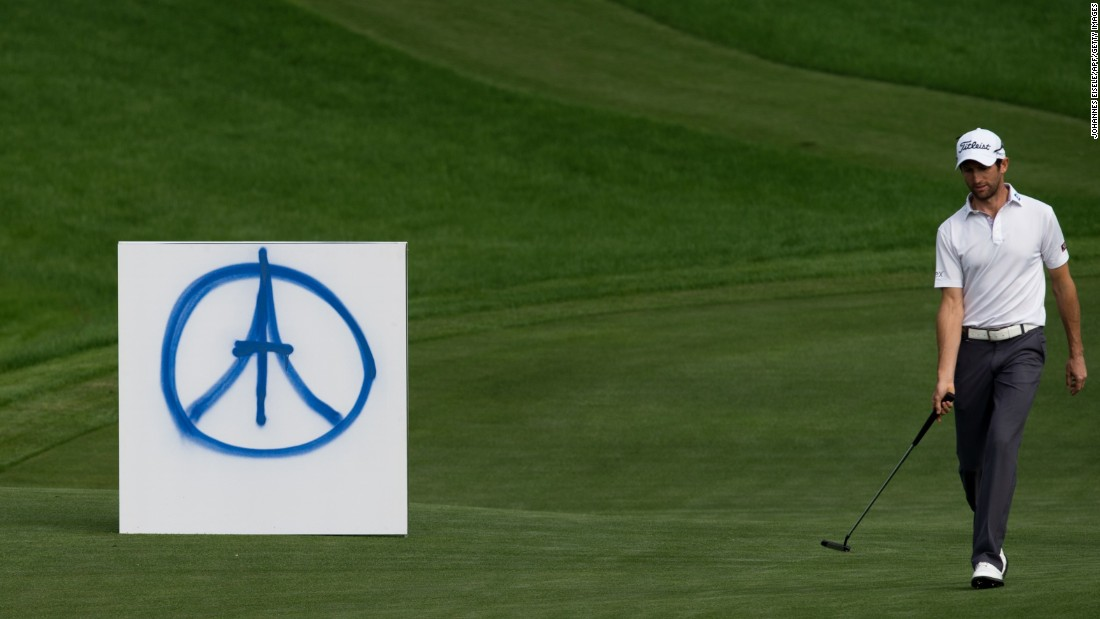 French golfer Gregory Bourdy passes a peace symbol for the Paris victims during the BMW Shanghai Masters tournament November 15 in Shanghai, China.