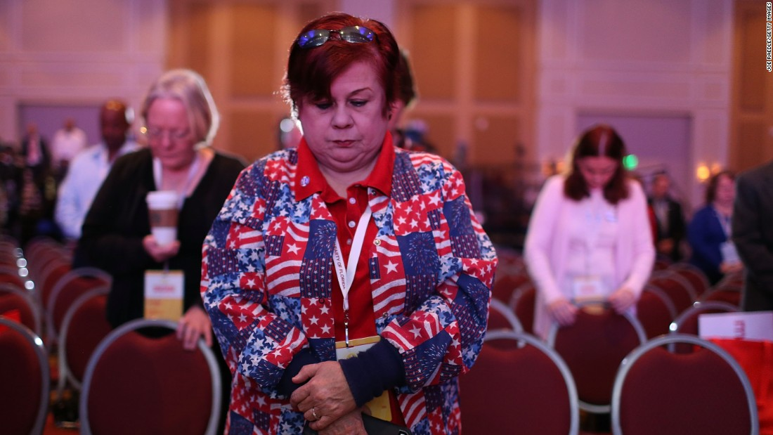Nancy Acevedo prays for France during the opening prayer for the Sunshine Summit being held at Rosen Shingle Creek in Orlando, Florida on November 14.