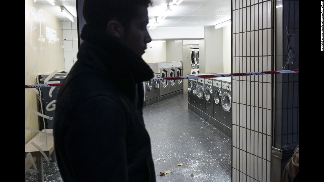 The windows of a laundromat on the Rue de la Fontaine au Roi were blown out in the attacks.