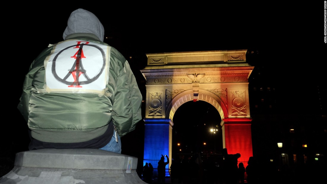 French graphic designer Jean Jullien's image of 'Peace for Paris' (the combination of a peace sign and an Eiffel Tower), has spread across the world, as people have adopted it to show support for French citizens, following a spate of deadly attacks in Paris on November 13. The Washington Square Park arch in New York is lit with the French national colors. This New Yorker wears the 'Peace for Paris' symbol on his back.