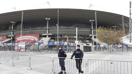 Police secure the area outside the Stade de France stadium, on the outskirts of Paris, on November 14, 2015. Three loud explosions were heard outside France's national stadium during the first half of a friendly international football match between France and Germany. At least four people died outside the glittering venue which staged the 1998 World Cup final with several others seriously hurt. Some128 people were killed in the Paris attacks on November 13 evening, with 180 people injured, 80 of them seriously, police sources told AFP. AFP PHOTO / MIGUEL MEDINA        (Photo credit should read MIGUEL MEDINA/AFP/Getty Images)