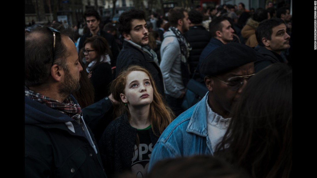 A crowd gathers on Rue Charonne on November 15 near the site of one of the attacks.