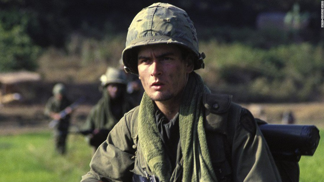 "As the son of actor Martin Sheen, he had small parts in some of his father's films. The public may have first become aware of him as a thuggish visitor in a police station making conversation with Jennifer Grey in 1986's ""Ferris Bueller's Day Off."" That same year, Sheen starred in Oliver Stone's Oscar-winning film ""Platoon,"" playing Chris, a soldier in Vietnam caught in a battle between Willem Dafoe and Tom Berenger."