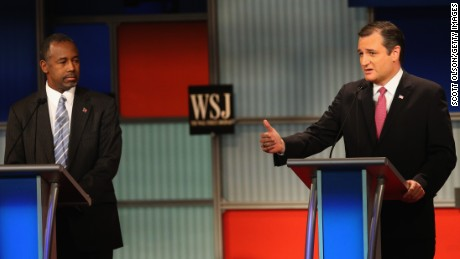 Presidential candidate Sen. Ted Cruz (R-TX) speaks while Ben Carson looks on the during the Republican Presidential Debate sponsored by Fox Business and the Wall Street Journal at the Milwaukee Theatre November 10, 2015 in Milwaukee, Wisconsin.