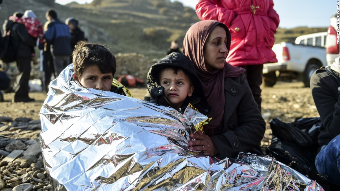 A Syrian family waits after arriving on the Greek island of Lesbos along with other migrants and refugees, on November 17, 2015. Ten of the 11 countries most affected by terrorism also have the highest rates of refugees.