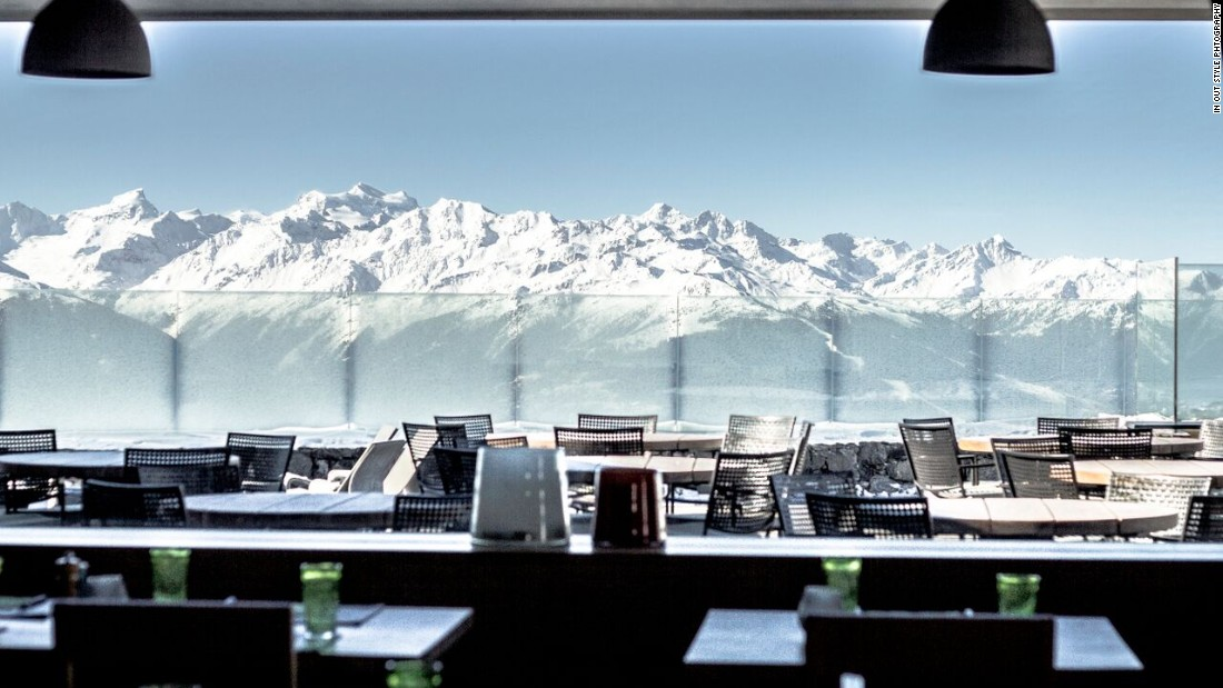 Hotel Chetzeron's huge restaurant windows reveal snow-covered Alpine peaks.